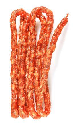 dry sausage: Thin dry sausage. Kabanos.  Isolated on white background. Stock Photo