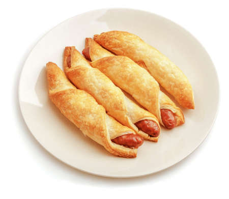 Sausage rolls isolated on white background.