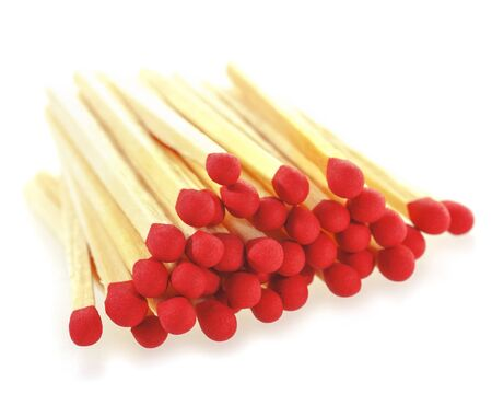 consumable: Stack of matchsticks on a white background. Soft focus view. Stock Photo