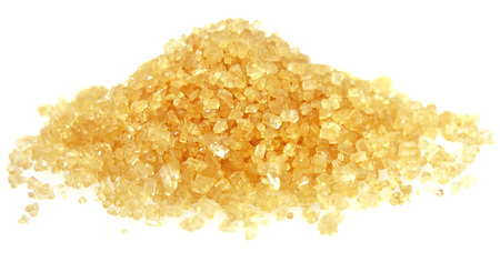 fine cane: Heap of golden Cane Sugar.  Isolated from white background. Soft focus view.