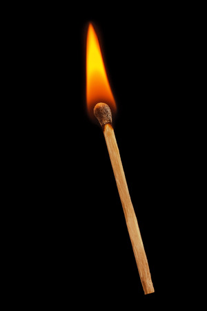 Matchstick on a black background. Soft focus view.