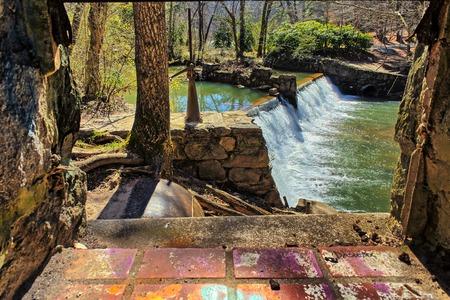 window graffiti: Taken on January 29, 2016 - Lullwater Waterfall Spillway Through a window Stock Photo