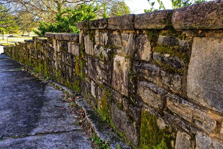 Rock wall with moss Фото со стока