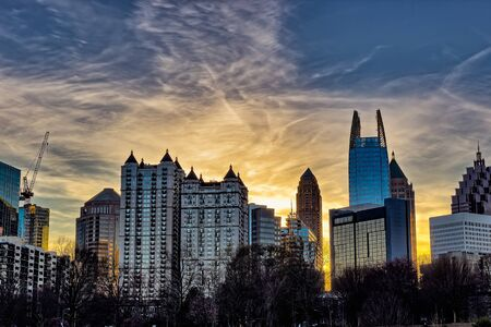 atl: Downtown Atlanta sunset with buildings in the  foreground