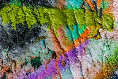 deteriorated: Grungy peeling colorful paint on a concrete  wall