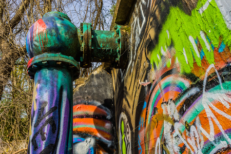 Large pipe with colorful paint  on it Stock Photo