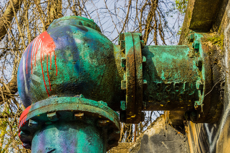 Large pipe with colorful  paint on it