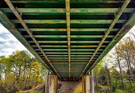 Rusty underside of a rail road  bridge Stock Photo