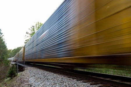 freight train: Freight train moving fast on rail road  tracks