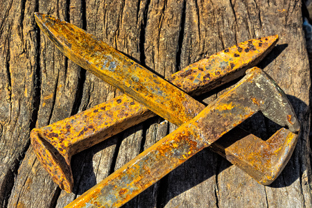 railroad: Rusty railroad spikes laying on ground in a  pile