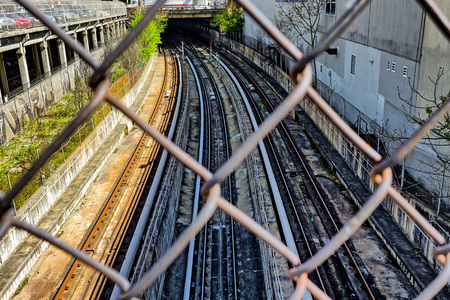 Underground train tracks leading to a  tunnel Stock Photo