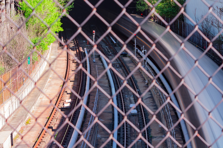 Passenger train moving quickly into underground  tunnel