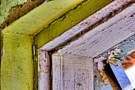 Peeling paint on walls of a  building