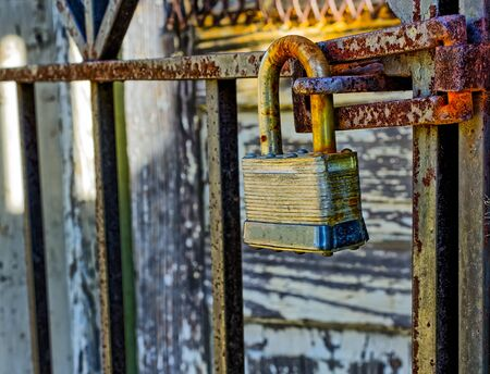 Rusty, old, locked padlock on a latch  vertically Stock Photo