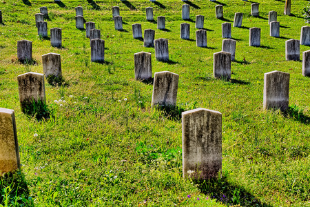 unmarked: Rows of old, marble, unmarked grave  headstones