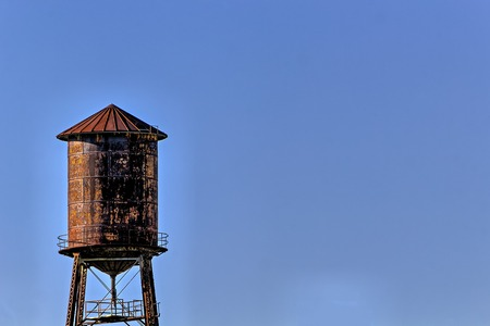water tower: Old, rustic water tower with blue sky  background