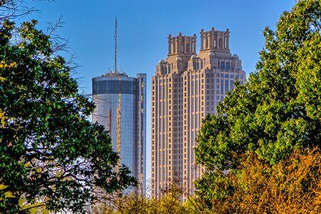atl: Atlanta cityscape buildings in between green  trees