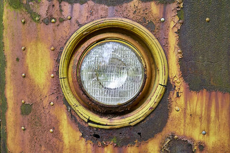 Rusted, Yellow Round Old Car Head Lamp Stock Photo