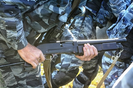 Russian police weaponsRussian police weapons in the hands of an officer photo