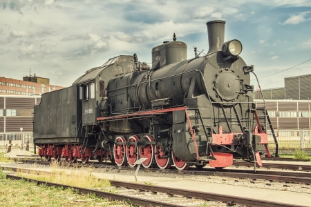 the old steam locomotive in the depot photo