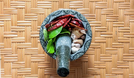 herbs and spices with stone mortar  photo