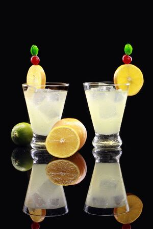 tom collins: A couple of Tom Collins on black Stock Photo