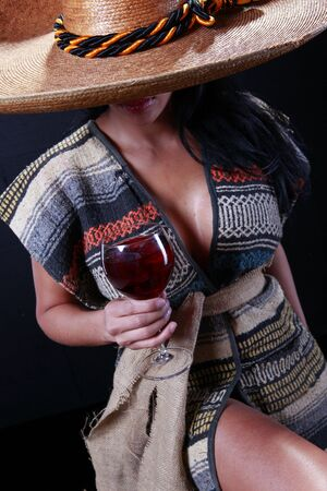 serape: Girl wearing serape and mexican hat holding a glass of wine 1