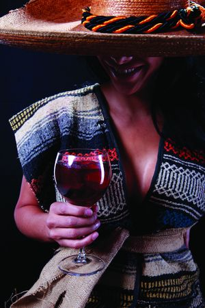 serape: Girl wearing serape and mexican hat holding a glass of wine 2