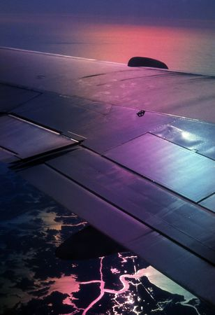 diffraction: High altitude diffraction colors aircraft window view at sunset with a rainbow over wing 2 Stock Photo