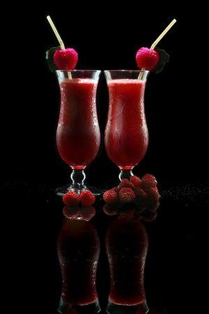 A couple of Raspberry Daiquiri on black