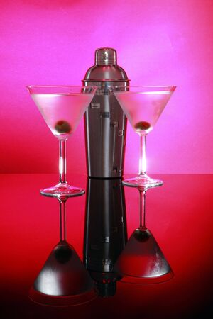 stirred: Pink Martinis and shaker, not stirred rim level full frame