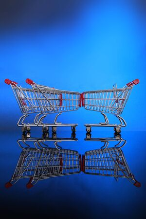 Grocery carts, one against the line Stock Photo - 4675552