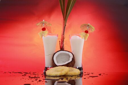 Frozen Piña Coladas, coconut and pineapple slices horizontal photo