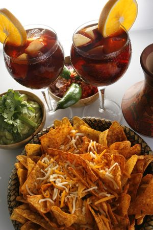 Sangria, corn chips and guacamole photo