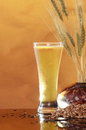 Tall cool beer, wheat and barley lots of room to your left Stock Photo - 4689637