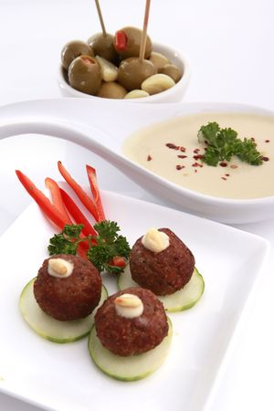 cater: Fried Kibbe and hummus tahine Stock Photo