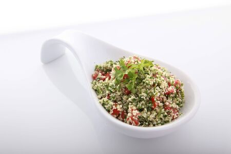 cater: Tabouli, greek or arab salad containing parsley and bulgur wheat