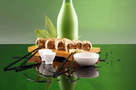 Green Eel roll and sake photo