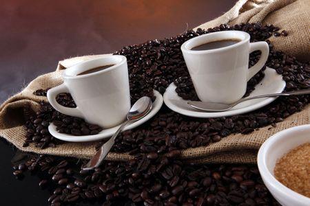 2 black coffee cups, grains, sisal sack and raw sugar Stock fotó - 4848879