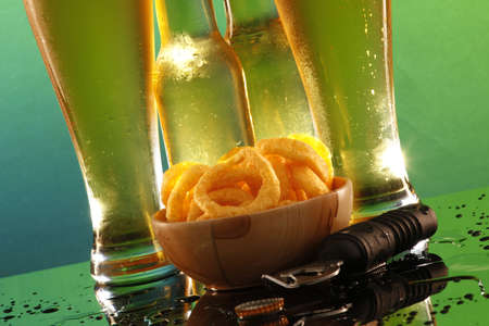 Tall cool beer and onion rings Stock Photo - 4914849
