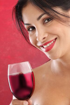 Cute brunette drinking red wine Stock Photo - 5036970