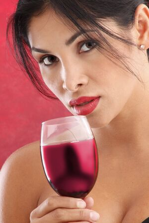Cute brunette drinking red wine photo