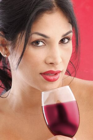 Cute brunette drinking red wine Stock Photo - 5036968