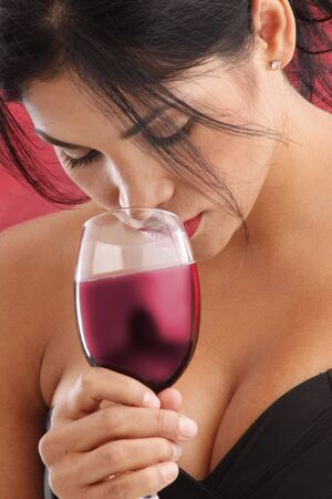 Cute brunette drinking red wine Stock Photo - 5036973