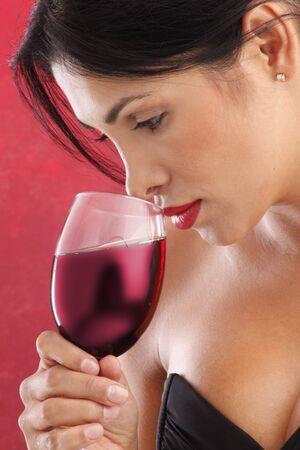 Cute brunette drinking red wine Stock Photo - 5036971