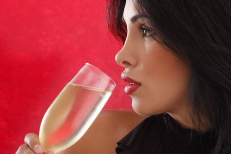 Cute brunette drinking cold white wine photo