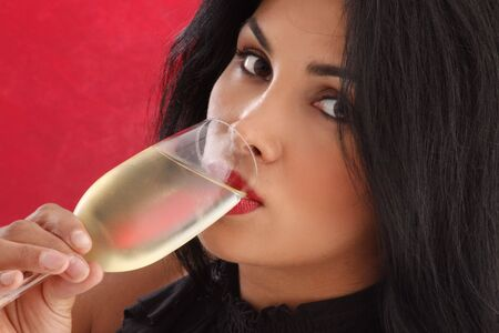 Cute brunette drinking cold white wine Stock Photo - 5141838