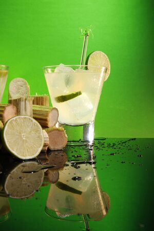 Caipirinha, whiskey sour or pisco sour with sugar cane and lime