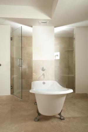 Bathtub full of steaming hot water photo