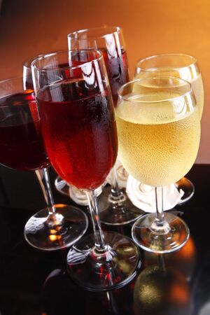 Two of each red, rose and white wine with roses